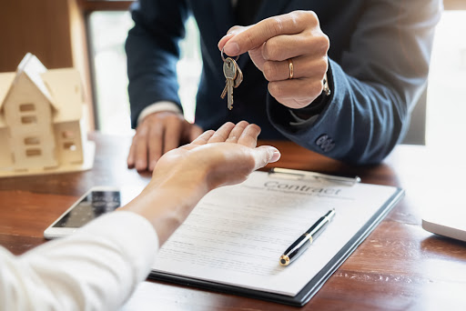 Real estate printers showing contract being signed