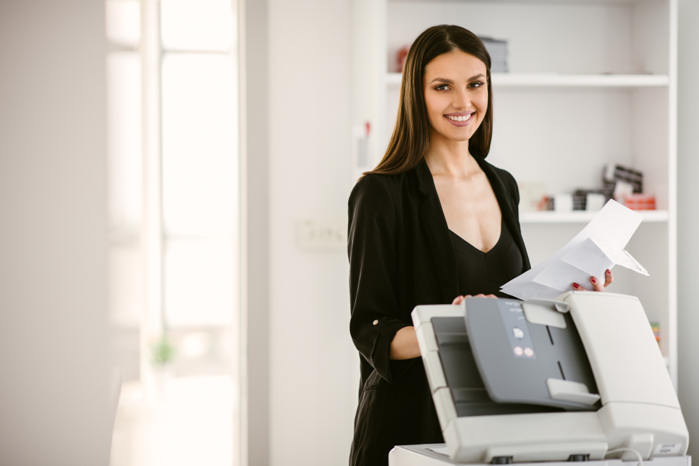 Woman using printer for real estate agents in Toronto