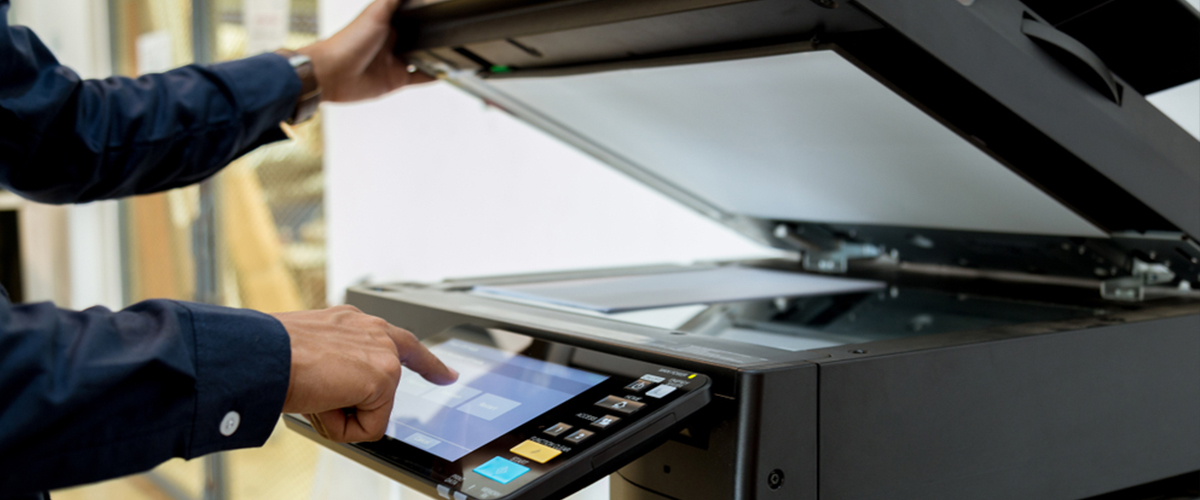 Man printing in office printer using access management