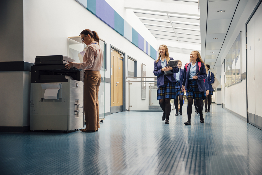 Students walking past printer in educational institution in toronto or mississauga