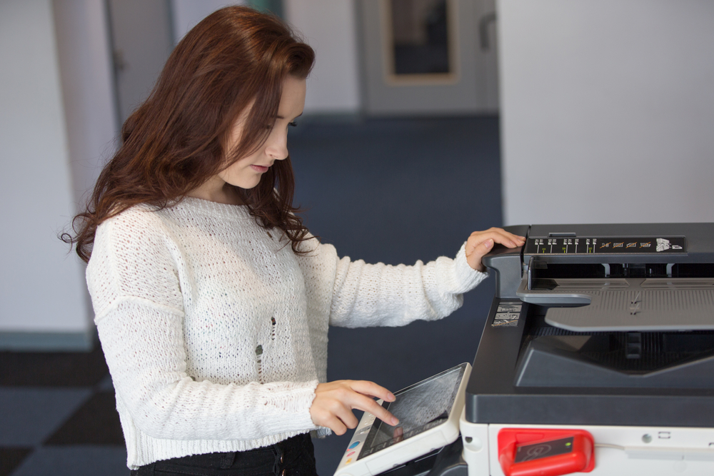 Woman using college printer in university in toronto