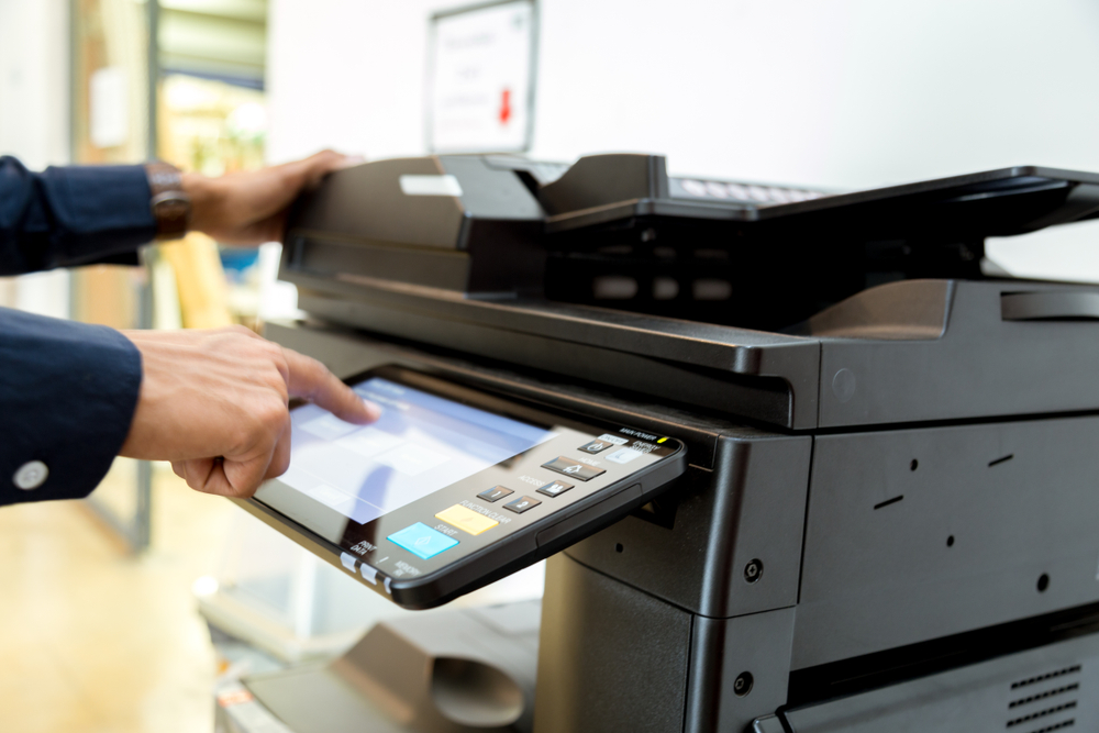 Lawyer using multifunction printer and copier in mississauga