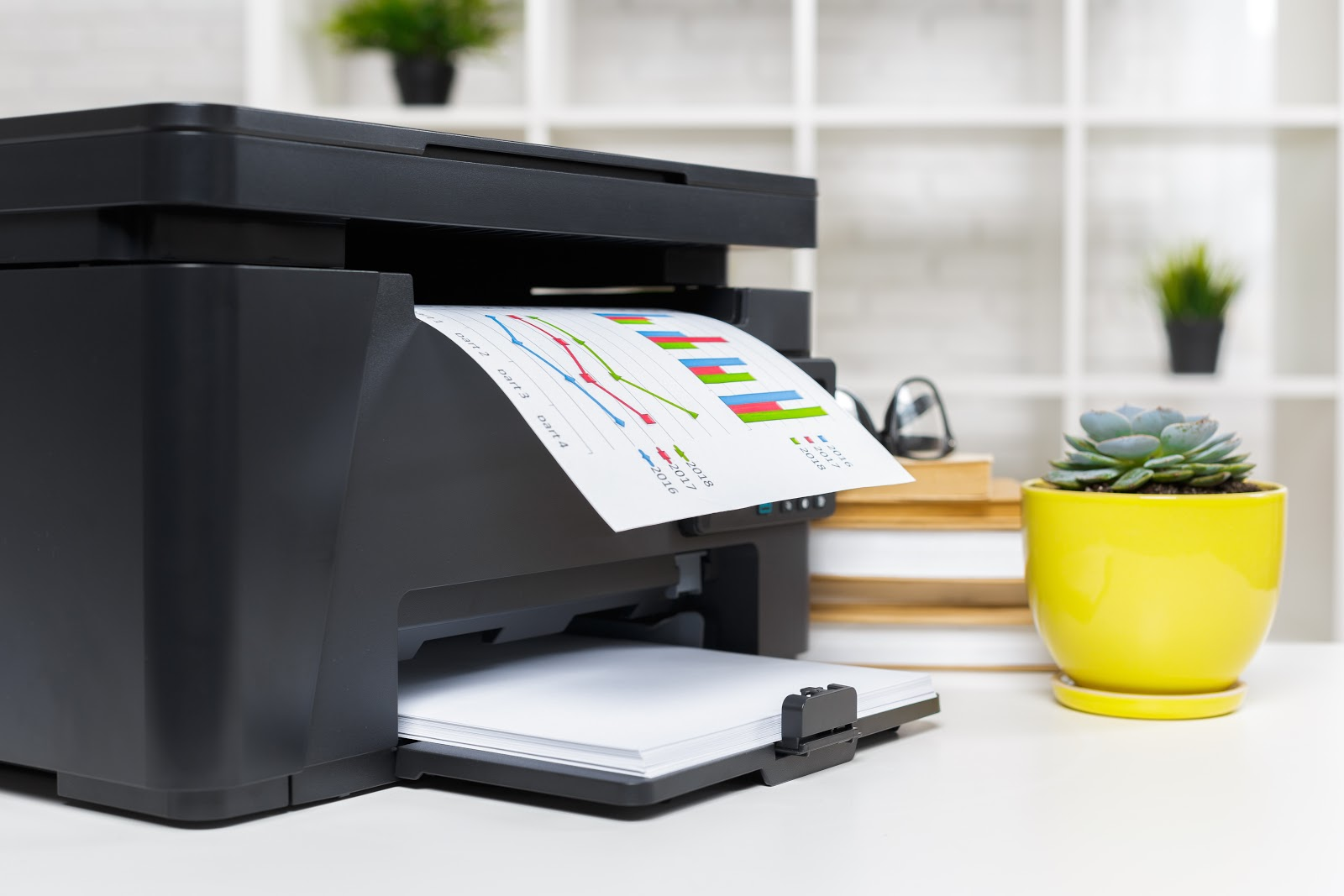 Close up of an office printer printing out a sheet