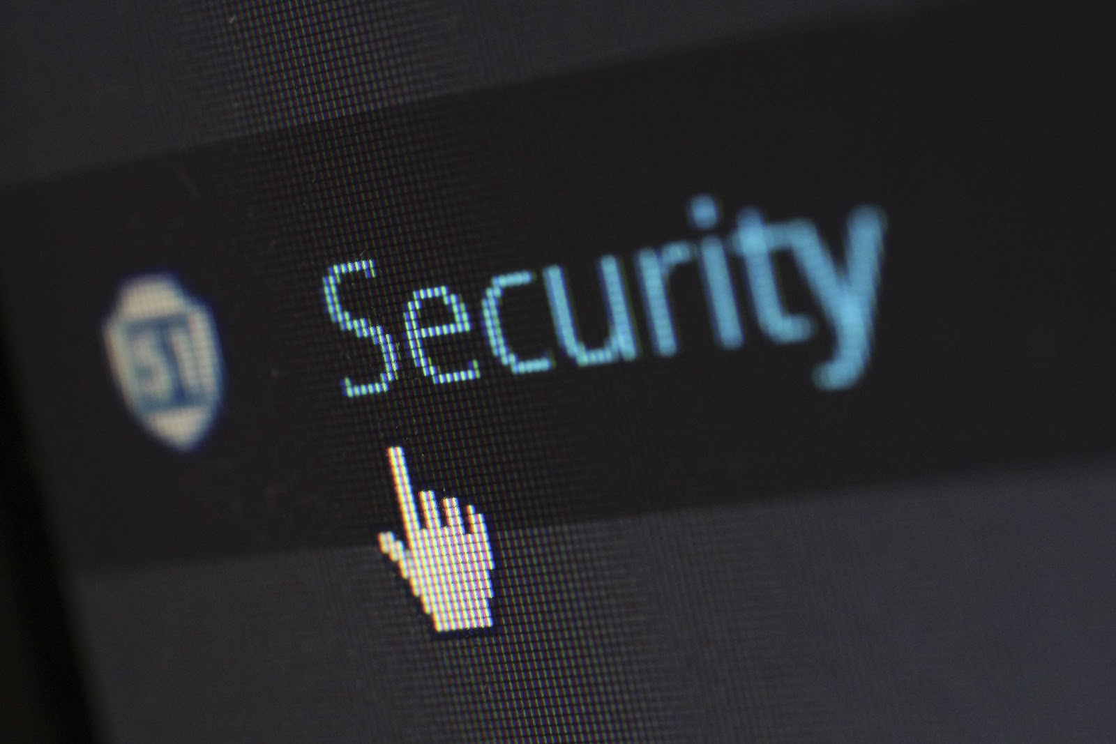 """Close up of a computer screen with a mouse hovering over the word """"security"""""""