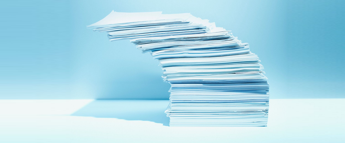 Stack of paper leaning slightly askew