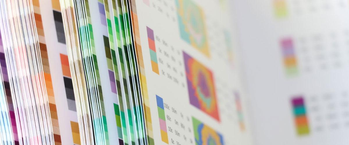 Multicoloured printing paper in a big sheaf.