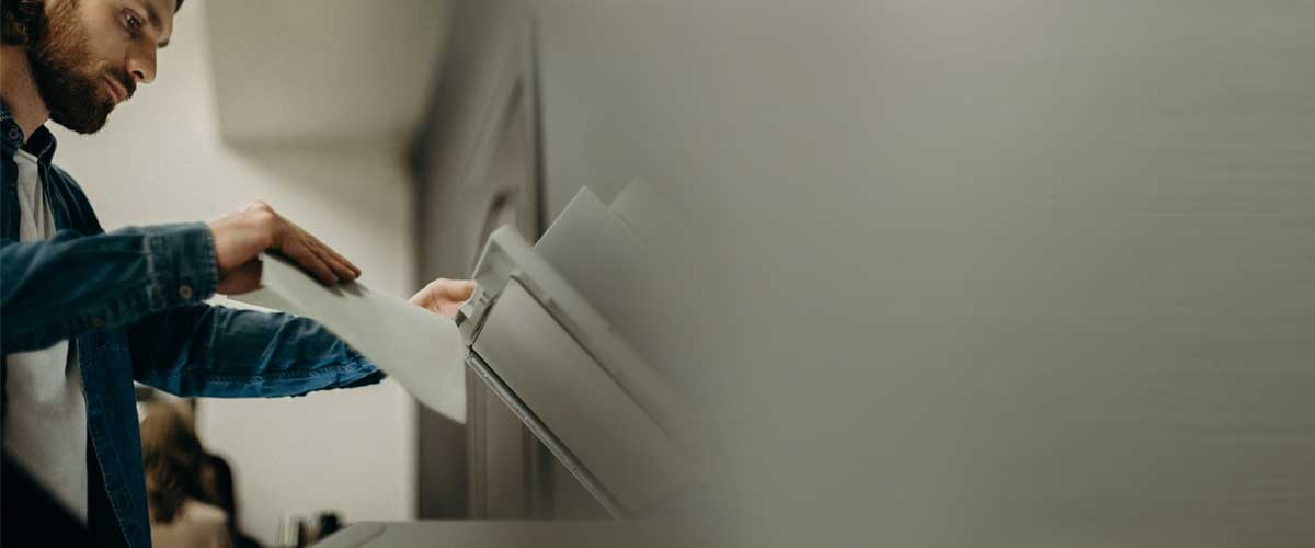 Man using business printers for lease Toronto