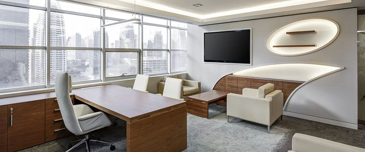 A sleek white office that features the panoramic view of the city.