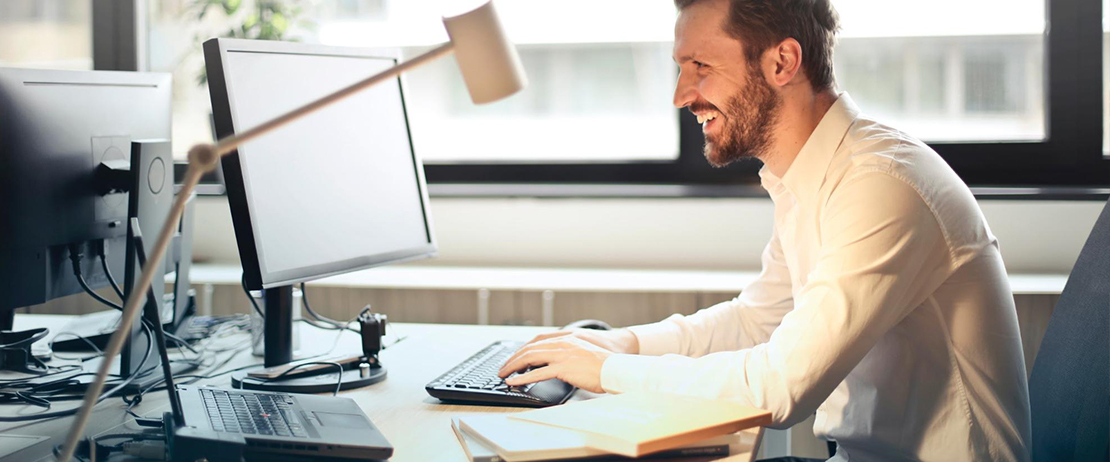 Employee sitting at his desk working productively