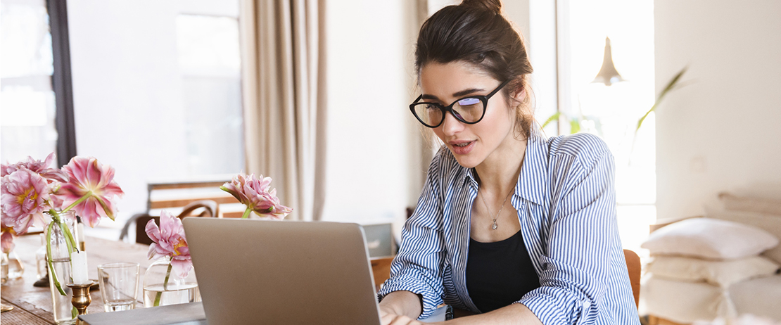 Woman works on her laptop from home