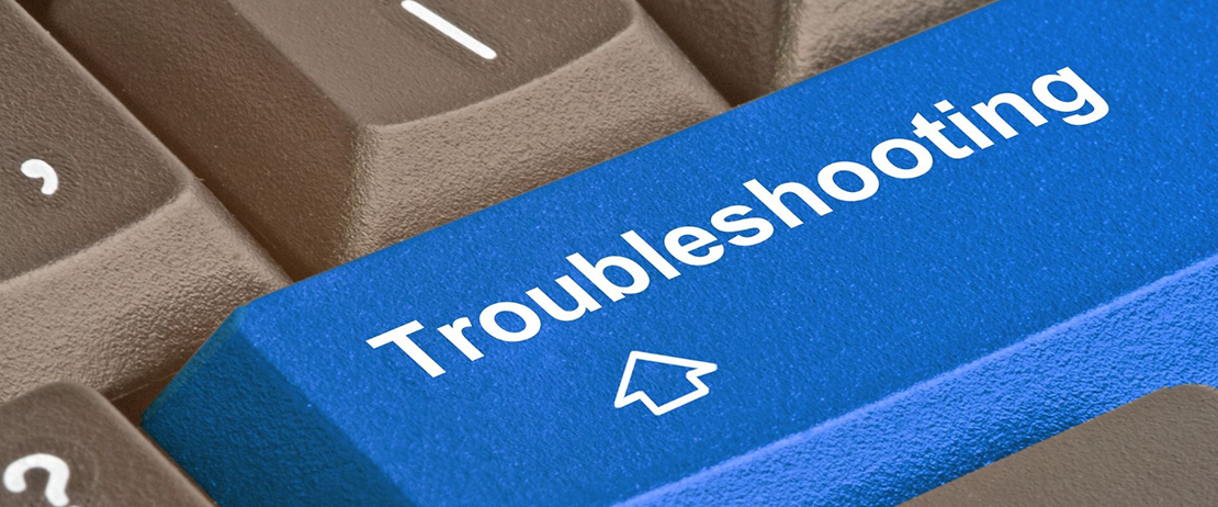 """A close-up of a keyboard with the word """"troubleshooting"""" indicated on a key"""