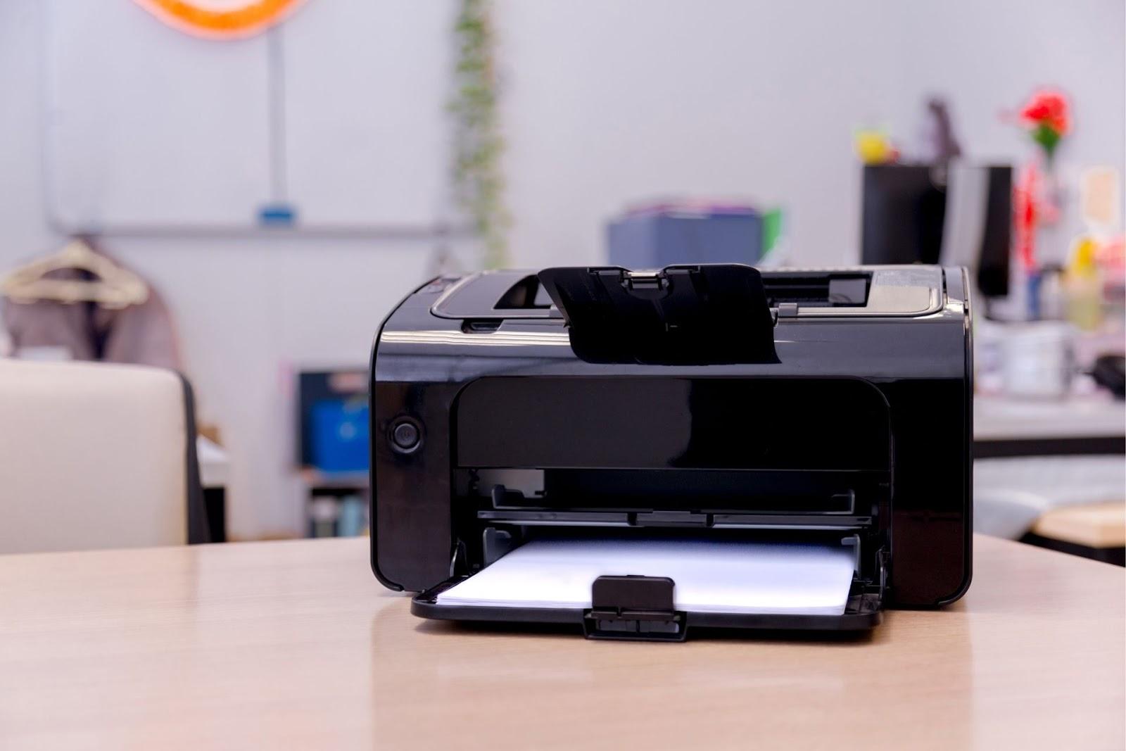 A black printer on a table