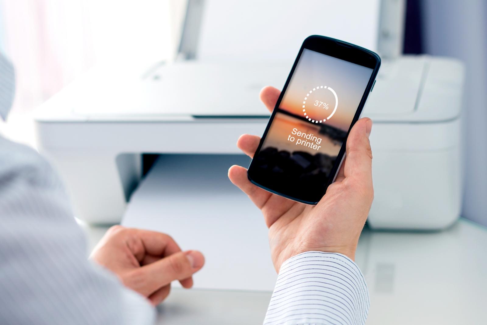 A mobile device sends a printing job wirelessly to a printer