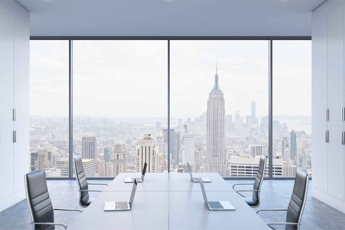 A meeting room with a cityscape view