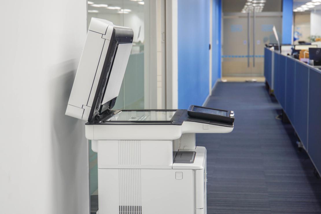 Multifunction printer in an office hallway