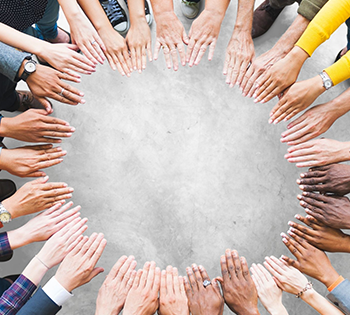 People holding their hands in a circle