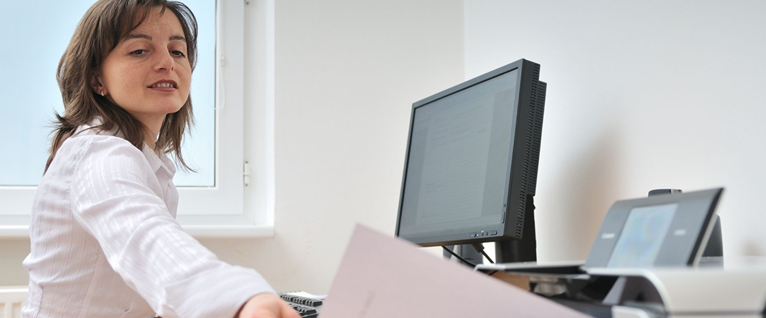 A person printing documents in an office