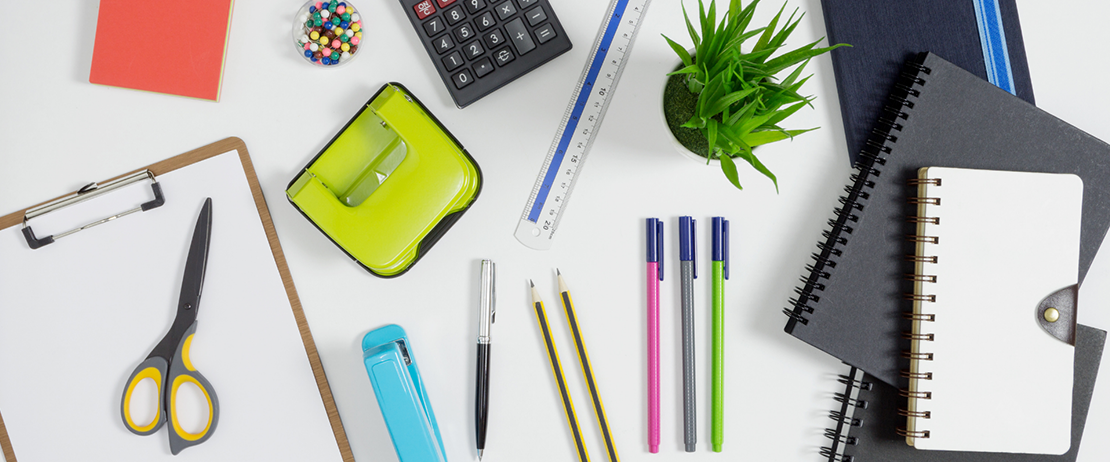 A flat lay of used office supplies