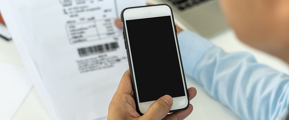 A person using his phone to scan documents with Google Drive.